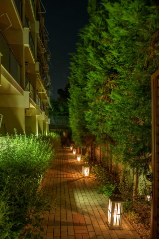 Gallery Galaxias Exterior area by the night and the garden