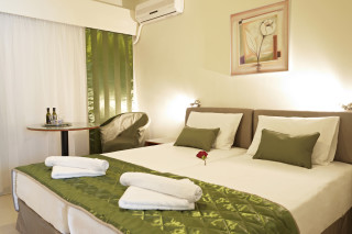 Standard Room Galaxias Luxury Bedroom with great decoration, table and air conditioning