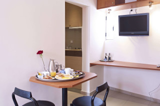 Suite Galaxias Dining Area where you can eat your breakfast while watching TV