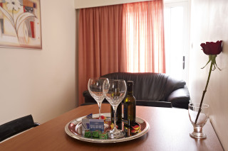 Suite Galaxias Sitting Area with table, chocolate and welcome drinks
