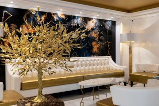gallery galaxias hotel cozy lobby with elegant sofas, painting and interior trees